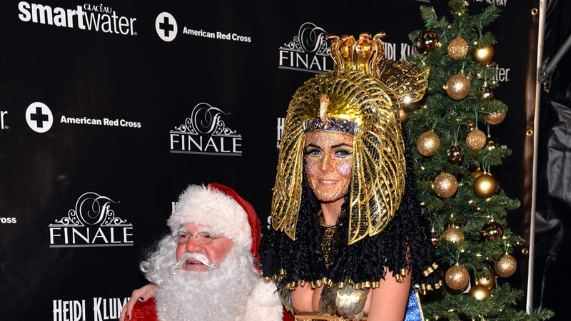 Illustration for article titled Heidi Klum Bedazzles Own Face and Sits on Santa's Lap For Halloween Party