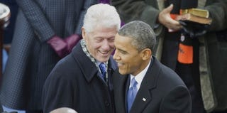 Former President Bill Clinton with President Barack Obama (Chris Maddaloni/Getty Images)