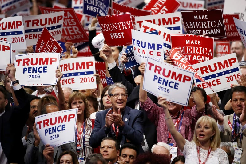 Delegates hold up signs in support of Republican presidential candidate Donald Trump and Republican vice presidential candidate Mike Pence during the Republican National Convention on July 20, 2016, in Cleveland. Win McNamee/Getty Images