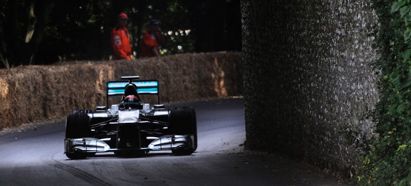 Johnny Herbert running a 2011 Mercedes W02 F1 car at Goodwood FoS 2014. Photo Credit: Getty