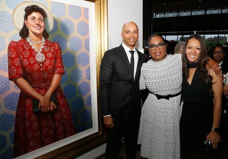 Artist Kadir Nelson, Oprah Winfrey and Jungmiwha Bullock stand beside Nelson's painting of Henrietta Lacks at the Washington, D.C., premiere of HBO Films' The Immortal Life of Henrietta Lacks on April 19, 2017..