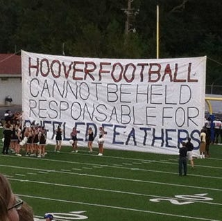 Illustration for article titled High School Cheerleaders Make Giant Sign With Giant Misspelled Word