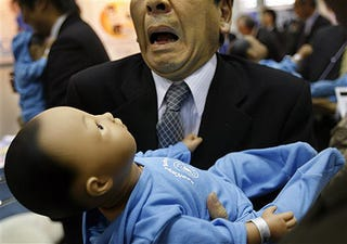 Illustration for article titled Robot Baby Cries; Actual Man Freaks Out