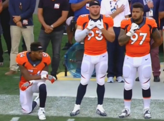 Denver Broncos linebacker Brandon Marshall (left), who says he has ended his protest of social injustice during the playing of the national anthem at the start of NFL gamesWTVR Screenshot