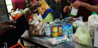 Clients at a food pantry in New York City (Spencer Platt/Getty Images)