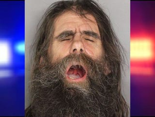 Illustration for article titled man throws spear at car, does passable Capt. Caveman impersonation