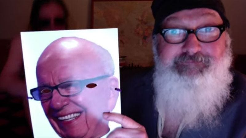 Illustration for article titled Randy Quaid returns by humping his wife while she wears Rupert Murdoch mask