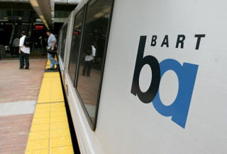 Commuters walking off a Bay Area Rapid Transit train in San Francisco, July 5, 2005Justin Sullivan/Getty Images