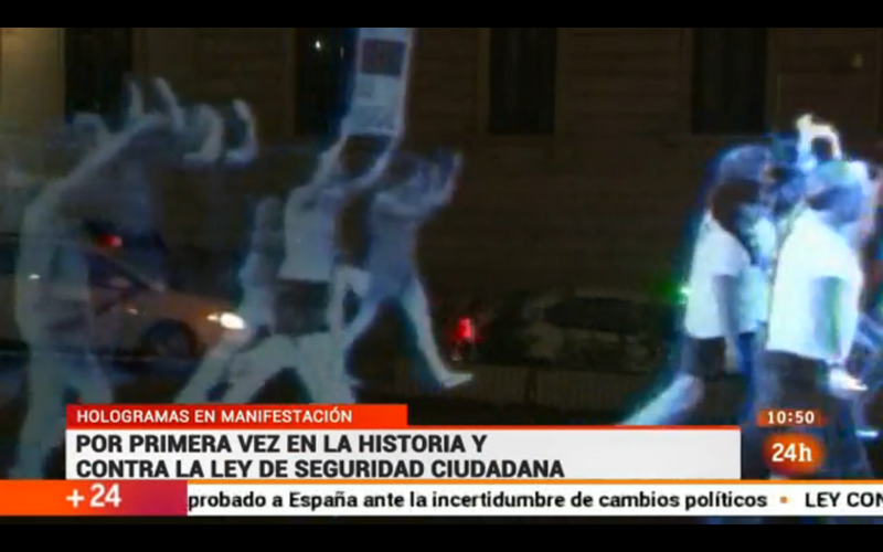 Illustration for article titled First-Ever Hologram Protest Takes to the Streets in Spain