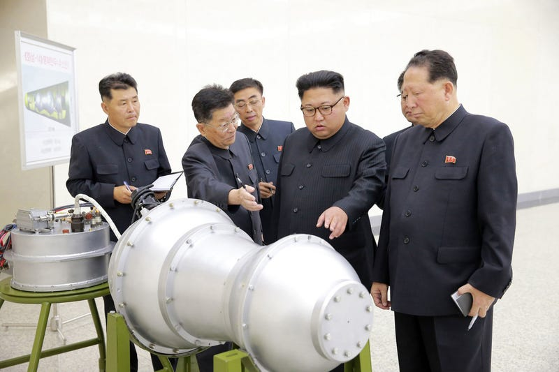 This undated file photo distributed Sept. 3, 2017, by the North Korean government, shows North Korean leader Kim Jong Un, second from right, at an undisclosed location in North Korea.  (Korean Central News Agency/Korea News Service via AP)