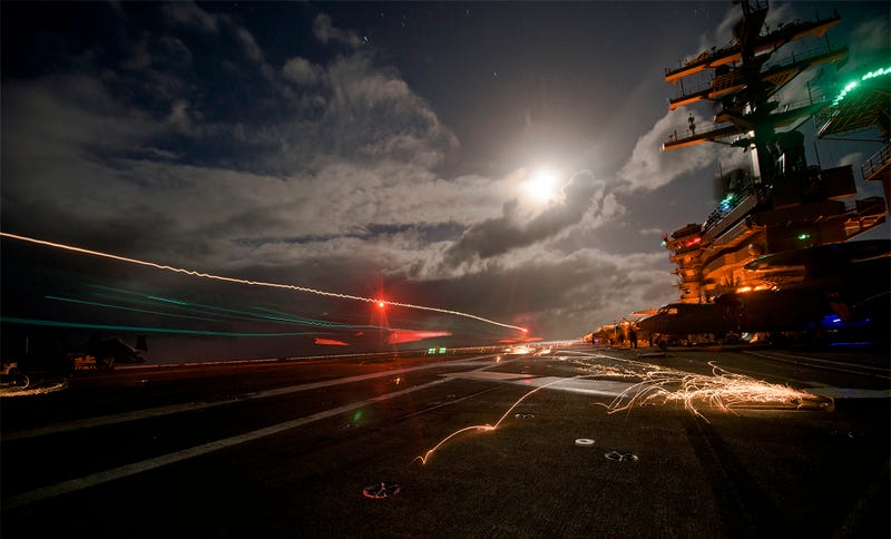 Illustration for article titled These Stunning Photos Capture Night Ops Aboard The USS Dwight D. Eisenhower