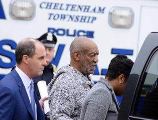 Bill Cosby is led from the Cheltenham police station after his arraignment at Montgomery County District Court on sexual assault charges Dec. 30, 2015, in Elkins Park, Pa.William Thomas Cain/Getty Images