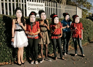 Illustration for article titled Amy Winehouse's Fans Put On Brave Face Outside Husband's Hearing