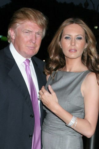 "Illustration for article titled Some Couples Match Outfits, Donald And Melania Match ""Serious"" Faces"