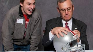 Illustration for article titled Photoshop Contest: Jim Tressel Signing Things!
