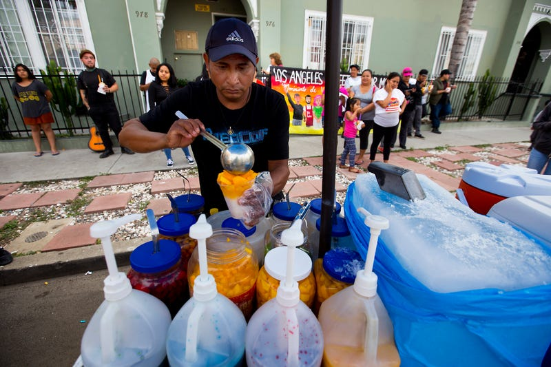 A street-cart vendor serves up ice and fruit in Hollywood, Calif. (Francine Orr/Los Angeles Times via Getty Images)