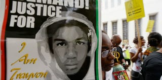 """A protester holds a sign at a """"Justice for Trayvon"""" rally in Los Angeles. (Kevork Djansezian/Getty Images)"""