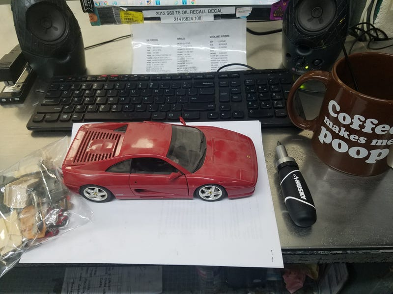Illustration for article titled Work continues at the desk top Fezza body shop