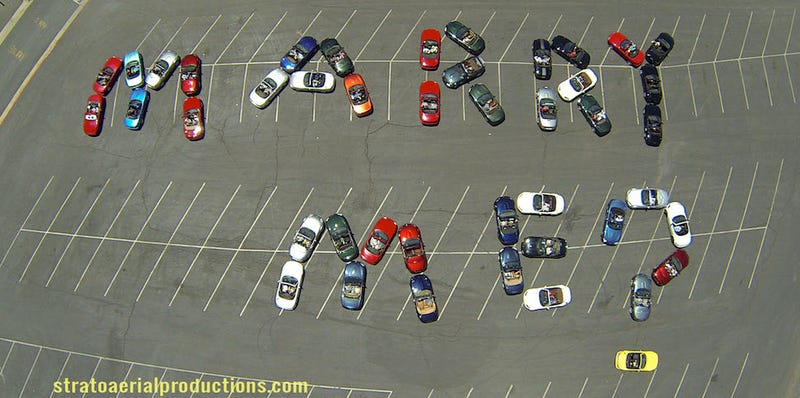Illustration for article titled Man Uses 44 Miatas To Pull Off Greatest Proposal World Has Ever Seen