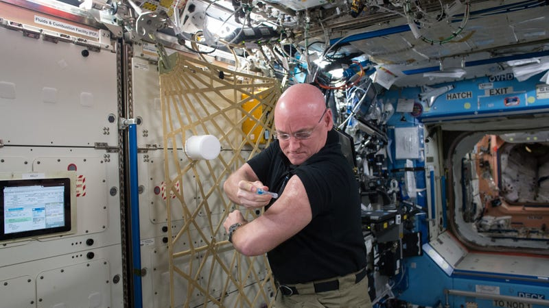 Yep, this is an astronaut (Scott Kelly) giving himself a flu shot. Photo by NASA via Getty Images.