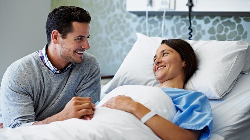 Man visiting woman in the hospital.