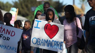 Supporters of the Affordable Care Act march in the 29th annual Kingdom Day Parade on Jan. 20, 2014, in Los Angeles.  David McNew/Getty Images