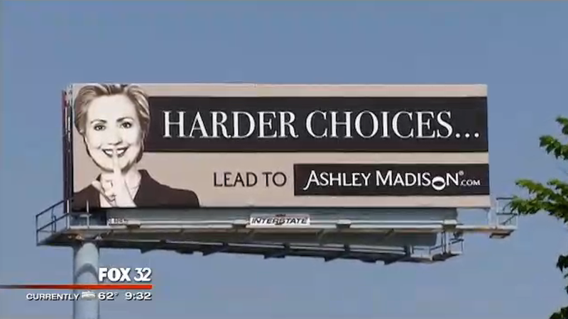 Illustration for article titled Of Course Ashley Madison Stuck Hillary Clinton's Image on a Billboard