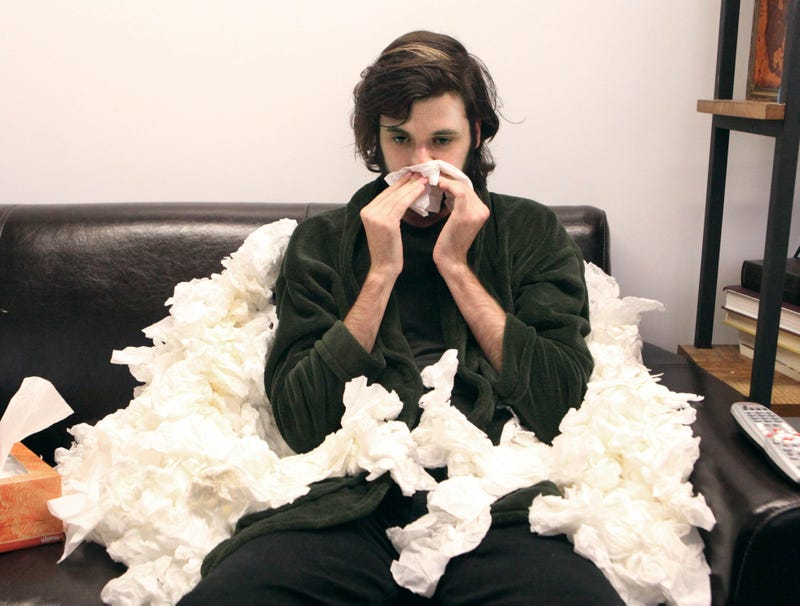 sick-man-slowly-becoming-enthroned-used-tissues