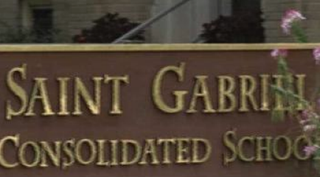 Signage at St. Gabriel Consolidated School in Glendale, Ohio, where an African-American boy's mother says her son and a female classmate were playing a staring game when her son was suspended.Fox 9 screenshot