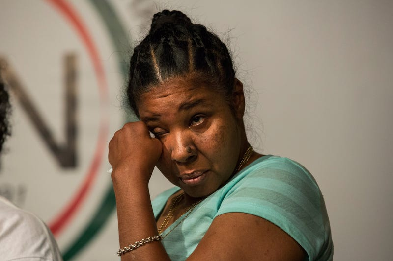 Esaw Garner, Eric Garner's wife, attends a press conference held with her familiy members and the Reverand Al Sharpton calling for further justice and legal action against the police officers responsible in the death of Eric Garner on July 14, 2015, in New York City.