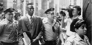 Defendant Yusef Salaam walks into courthouse flanked by police in The Central Park Five (Daily News/Getty Images)