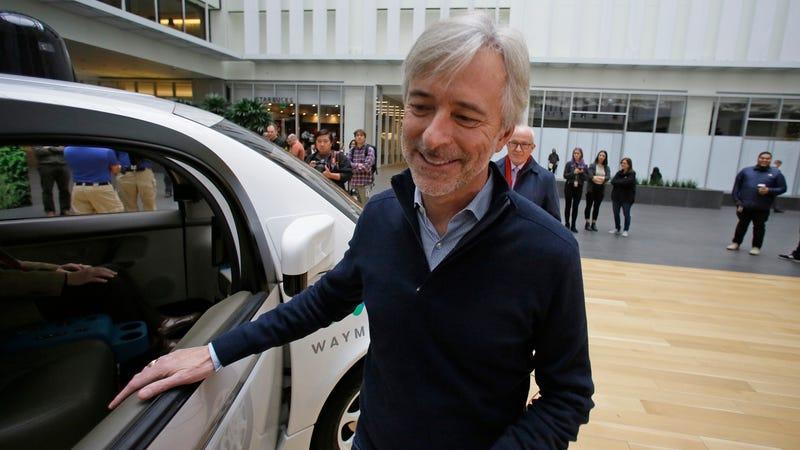 Waymo CEO John Krafcik prepares to step inside a driverless car during a Google event. Photo: AP