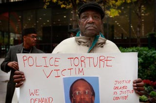 Aaron Cheney demonstrates on Oct. 27, 2008, outside the federal courthouse in Chicago as former Chicago Police Cmdr. Jon Burge attended a hearing on charges that he obstructed  justice and committed perjury during a 2003 civil trial about decades-old Chicago police torture allegations in Chicago.Scott Olson/Getty Images
