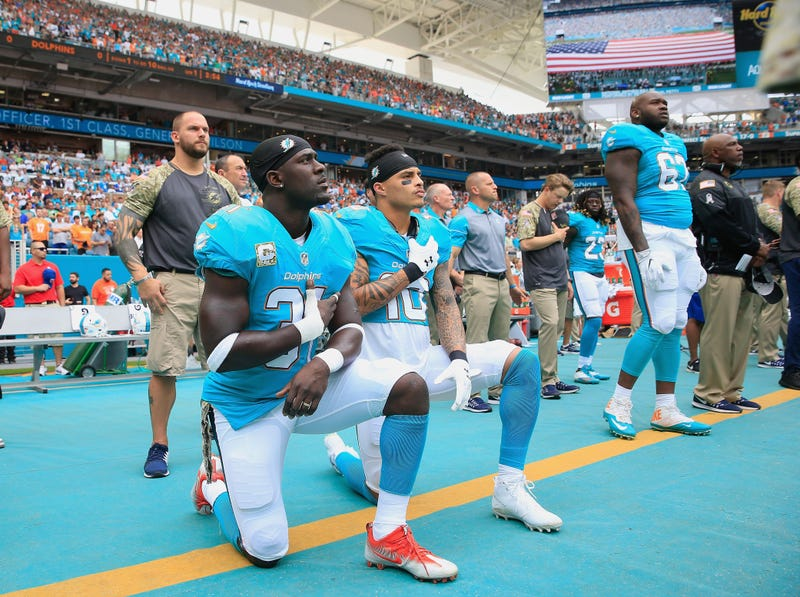 Michael Thomas #31 of the Miami Dolphins and Kenny Stills #10 of the Miami Dolphins take a knee during the national anthem prior to the game against the New York Jets at the Hard Rock Stadium on Nov. 6, 2016, in Miami Gardens, Fla.