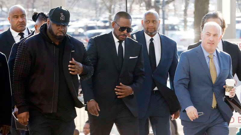 Singer R. Kelly (C) arrives for his court date at the Leighton Courthouse on March 22, 2019 in Chicago, Illinois. R. Kelly appeared before a judge to request permission to travel to Dubai to perform in several concerts.