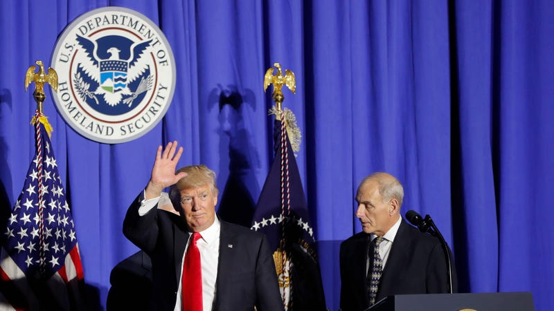 President Donald Trump, followed by then-Homeland Security Secretary John F. Kelly, at the Homeland Security Department in Washington, Wednesday, Jan. 25, 2017. (Photo: AP)