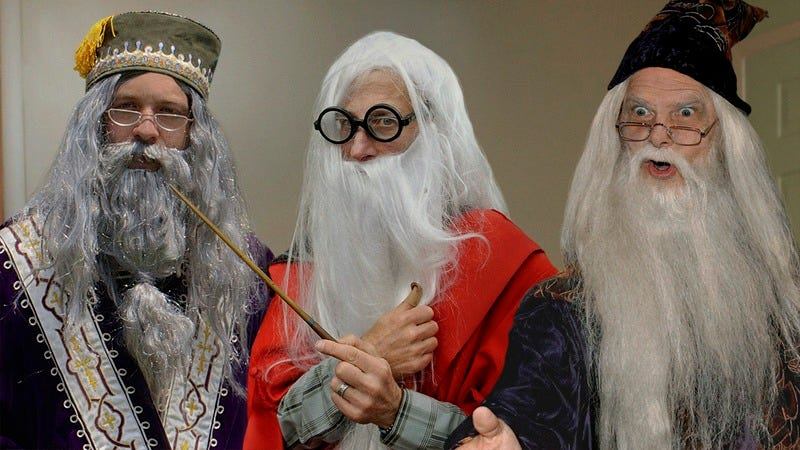 Three men dressed as Dumbledore