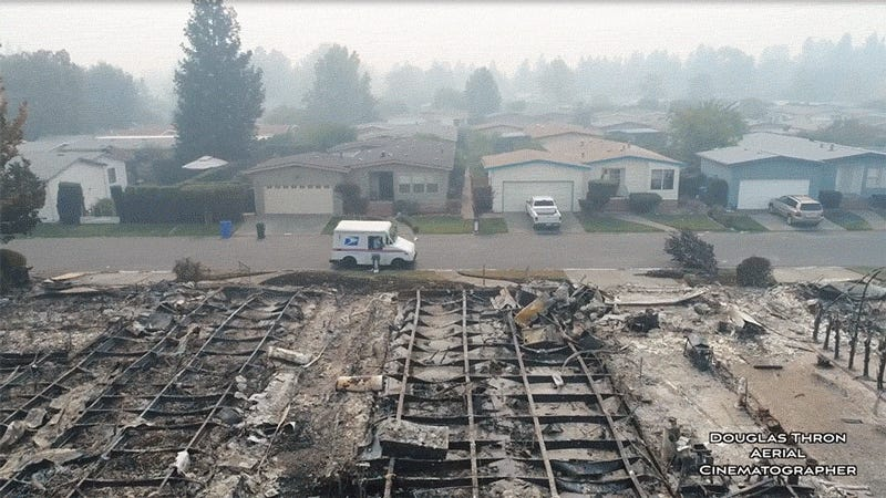 Eerie Drone Video Shows USPS Carrier Delivering Mail in Burned California Neighborhood