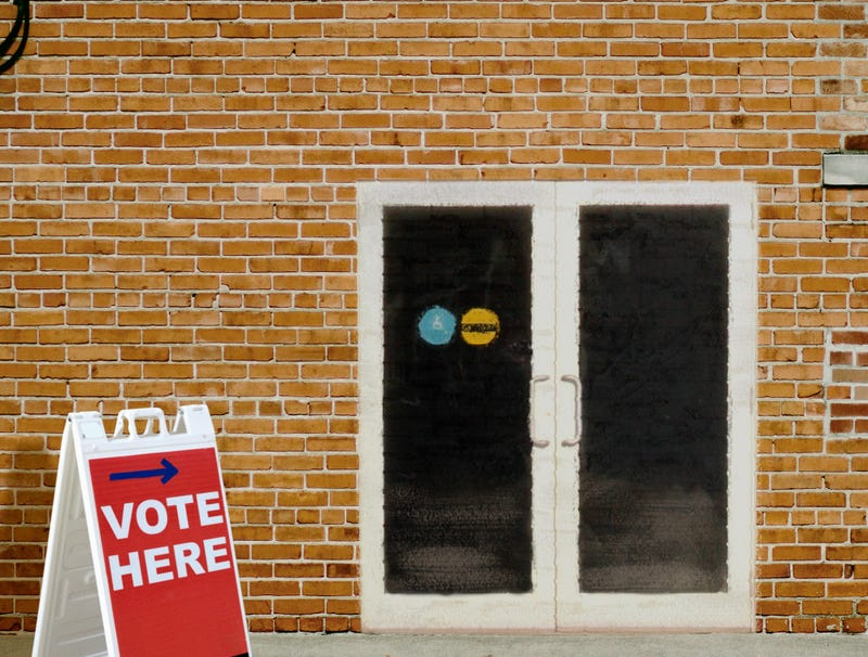 Illustration for article titled Polling Place In Predominantly Black Neighborhood Clearly Brick Wall With Door Painted On