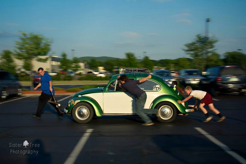Illustration for article titled Pushing 8 year olds around a car show in a Beetle.