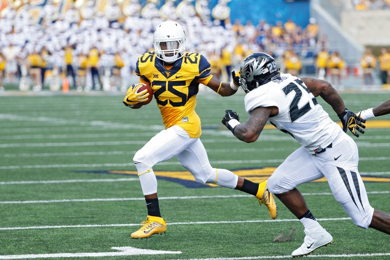 Justin Crawford of the West Virginia Mountaineers runs the ball against the Missouri Tigers in the first half of the game at Milan Puskar Stadium on Sept. 3, 2016 in Morgantown, West Virginia. West Virginia defeated Missouri 26-11.