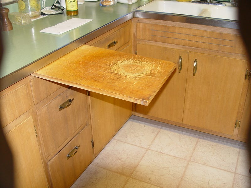 builtin cutting board drawer is a secret place to slice and dice,