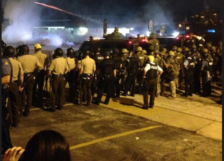 Illustration for article titled Ferguson Descends Into Chaos as Police Tear Gas Children, Media