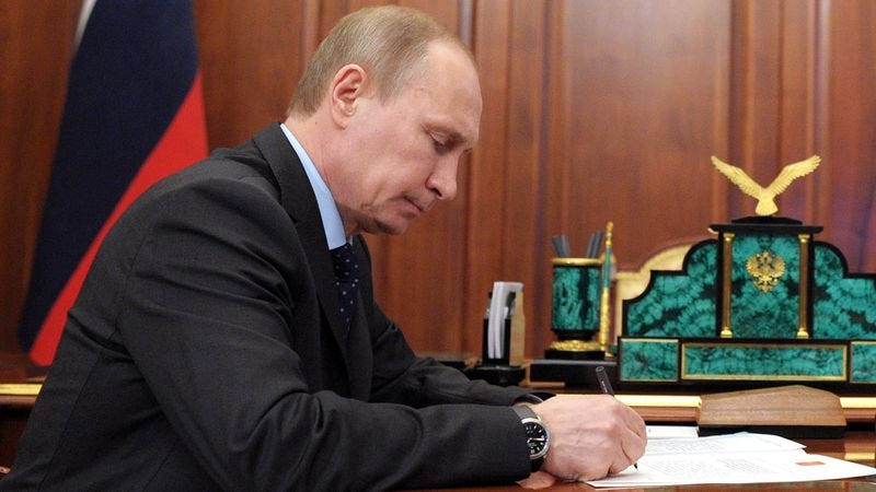 Illustration for article titled Putin Starts Off Morning By Sitting Down To Write The Day's News