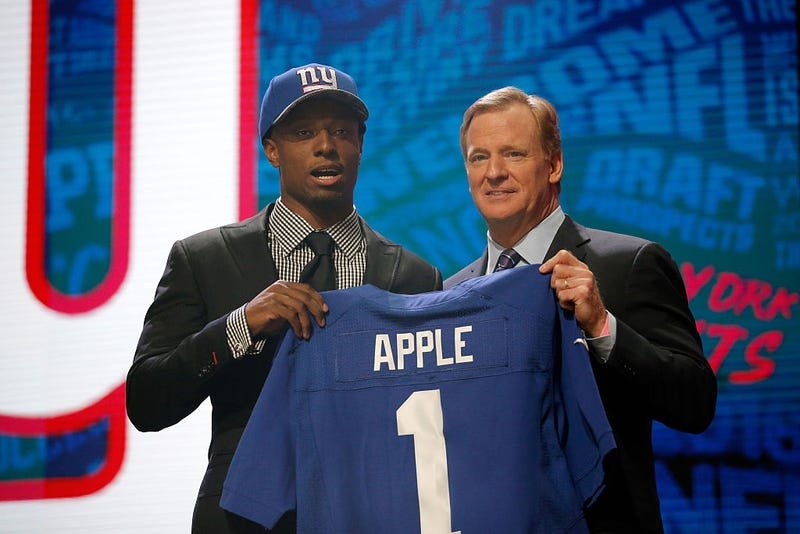 Eli Apple of Ohio State holds up a jersey with NFL Commissioner Roger Goodell after being picked No. 10 overall by the New York Giants during the first round of the 2016 NFL Draft at the Auditorium Theatre of Roosevelt University in Chicago on April 28, 2016.Jon Durr/Getty Images