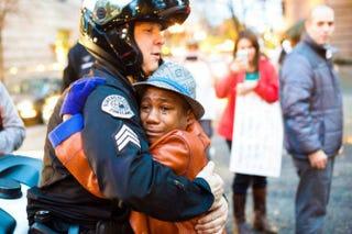 Portland, Ore., police Sgt. Bret Barnum (left) and Devonte Hart hug during a Ferguson rally in Portland last week.Johnny Nguyen