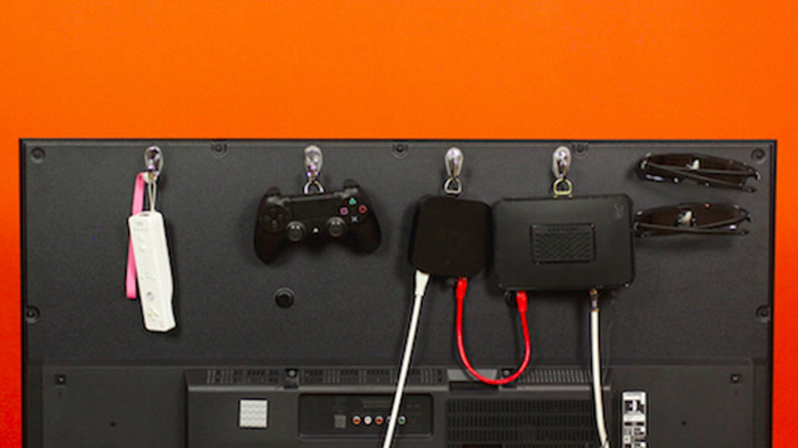 Hide Your Home Theater Accessories Behind Your TV with Sugru