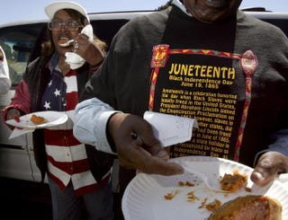 Naomi Williams and D'Emanuel Grosse Sr. taste the sweet potato pie entered in the cook-off contest at the Juneteenth, Black Independence Day, celebrations at Nichol Park on June 19, 2004, in Richmond, Calif. David Paul Morris/Getty Images