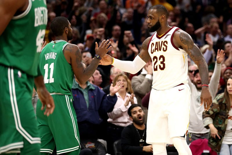 LeBron James, No. 23, of the Cleveland Cavaliers and Kyrie Irving, No. 11 , of the Boston Celtics shake hands after a Cavaliers 102-99 victory at Quicken Loans Arena on Oct. 17, 2017, in Cleveland. (Gregory Shamus/Getty Images)
