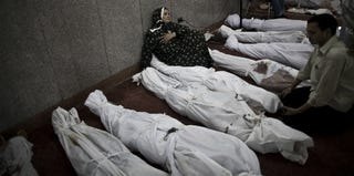A woman mourns the dead in a Cairo mosque. (Mahmoud Khaled/AFP/Getty Images)